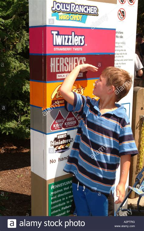 A boy seven 7 years old measures himself against the