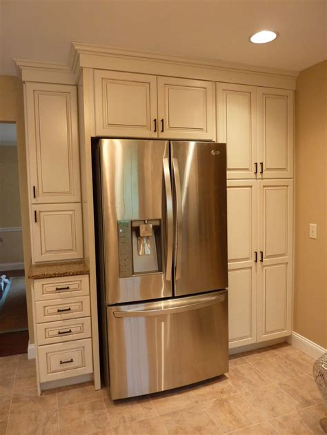 Kraftmaid offwhite cabinets with a glaze, build in the