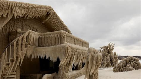 New York houses frozen in ice by water and wind from Lake