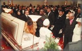 MOURNERS FILE BY the casket of civic leader Mildred Wells