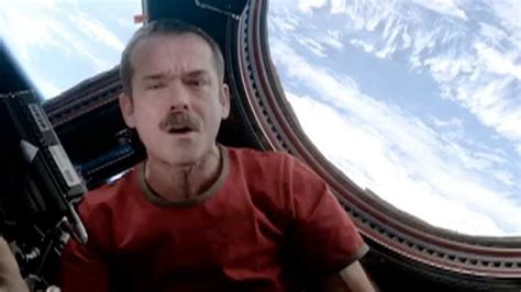 WATCH: Astronaut Chris Hadfield Covers Bowie's 'Space
