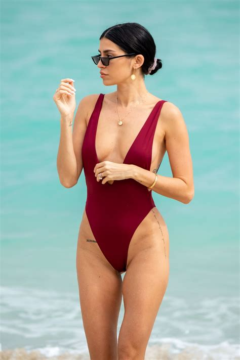 Nicole Williams In a one piece bathing suit ahead of her